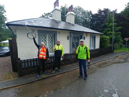Litter pickers on Bestwood Lodge Drive on a wet day