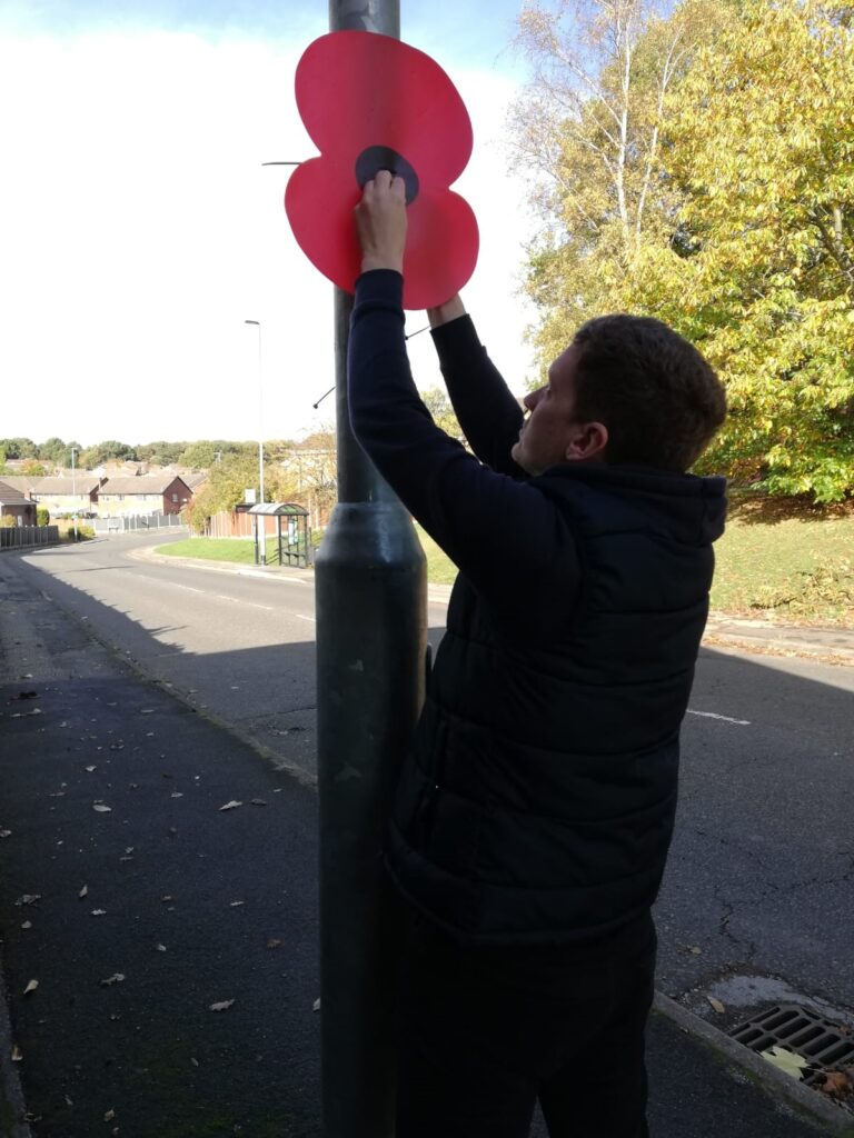 Putting up poppies on lamp-posts